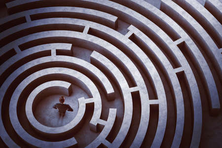 confusion: Businessman at the center of a maze