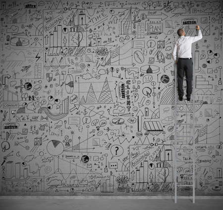 statistic: Businessman on a scale drawing on wall