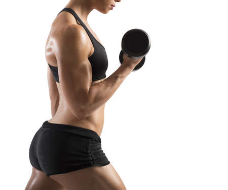 tricep: Athletic muscular woman training biceps with dumbbells Stock Photo