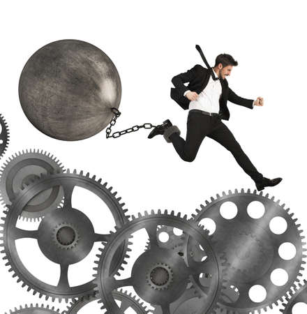 financial obstacle: Businessman jumps between gears with an impediment Stock Photo
