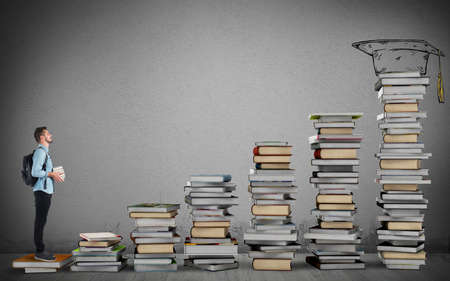 ladder: Student climbing a ladder of study books