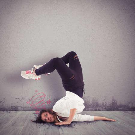 contracture: Girl dancer of breakdance hits her head