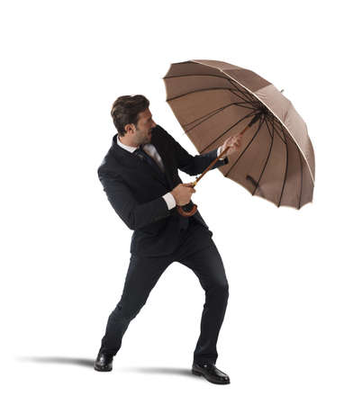 safeness: Businessman protect himself with umbrella on white background Stock Photo