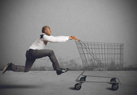 shopping carriage: Run to go shopping looking for deals Stock Photo