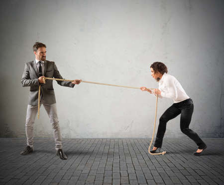conflicts: Rivals businessperson pulling a rope with force