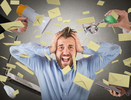 Stressed and desperate businessman screaming for chaos Stockfoto