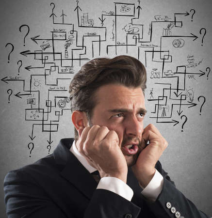 incertitude: Stressed man thinks worried an answer labyrinth