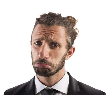 Portrait of sad businessman with sorrowful expression