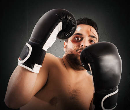 powerless: Frightened man boxer with plasters and bruises
