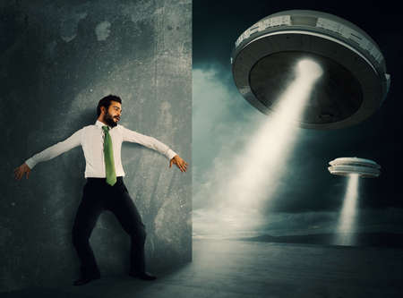 fear: Man hides frightened by UFO space shuttle