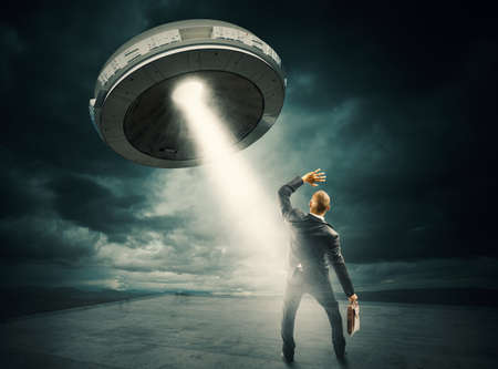 space invader: Frightened man by the UFO space shuttle