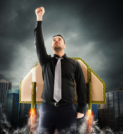 invincible: Businessman flying with cardboard wings with turbines Stock Photo