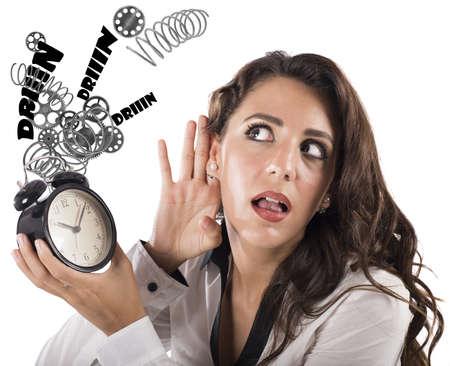 Businesswoman listening to the broken alarm ring