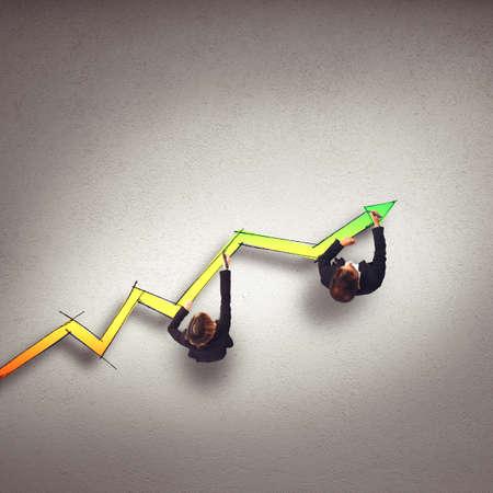 plots: Business people draw a big statistic arrow