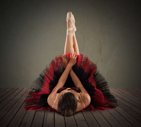 woman stretching: Pose of ballet dancer with legs extended Stock Photo