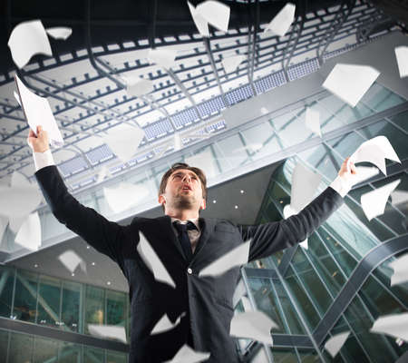 exult: In the office businessman exults throwing sheets