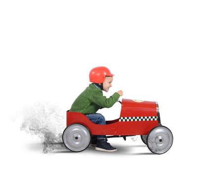 Child with helmet plays with the car
