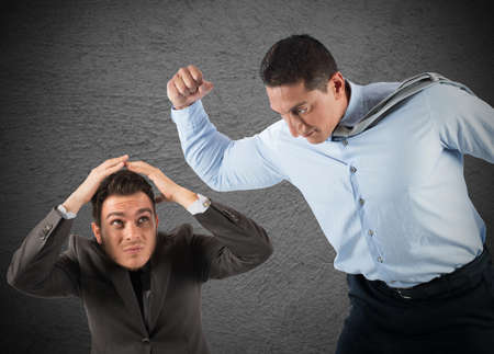 reprimand: Angry big boss punches the employee frightened Stock Photo
