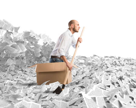debt trap: Man paddling in a sea of sheets