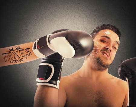 receives: Boxer receives punch from boxer with tattoo