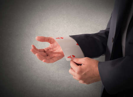 swindler: Businessman out of sleeve a poker card Stock Photo