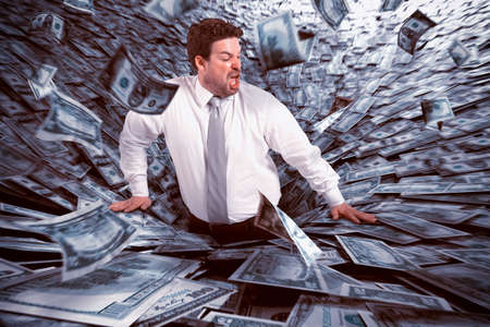 debt trap: Businessman swallowed by black hole of money Stock Photo