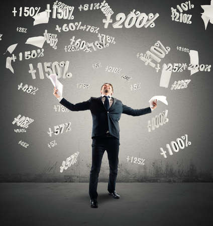 exult: Successful businessman rejoices with number percentage background Stock Photo