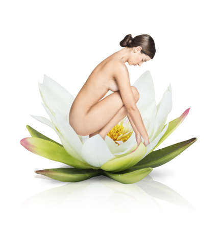 woman naked body: Naked model over a big flower lotus
