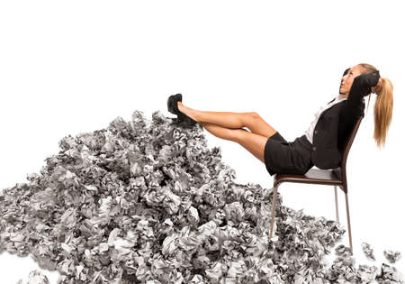 debt trap: Woman resting leaning on a pile of paper