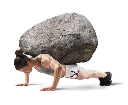 flexion: Muscular woman lifts a boulder with back