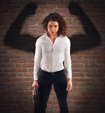 Businesswoman with angry expression and muscular shadow
