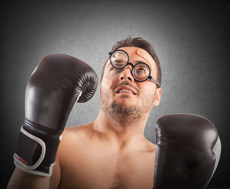 pugilist: Goofy boxer with nerd eyeglasses and plasters Stock Photo