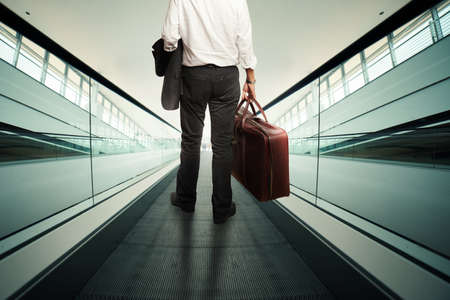 rise: Businessman rise with an escalator with baggage