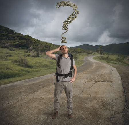 uncertainty: Boy explorer lost in a mountain path Stock Photo