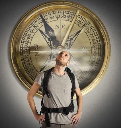 Explorer with uncertain expression with big compass