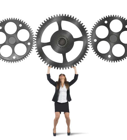 conjunction: Businesswoman holding a gear among other gears Stock Photo