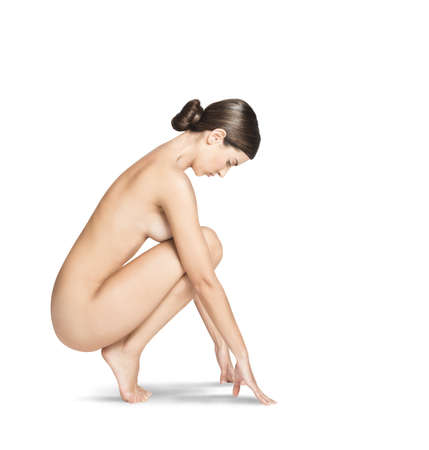 nudity woman: Fashion naked woman model sitting on tiptoe