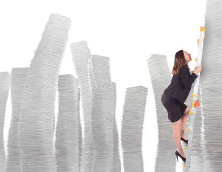 ascend: Businesswoman climbs on scale of sheets piles