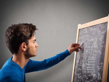 graphic design: Boy writes on the blackboard with chalk Stock Photo