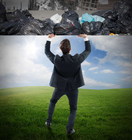 pushes: Man pushes the rubbish from clean nature Stock Photo