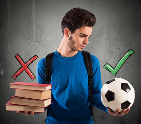 indecisive: Boy chooses the ball instead of books