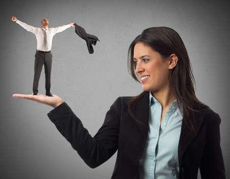 exult: Woman holds on hand an exultant man