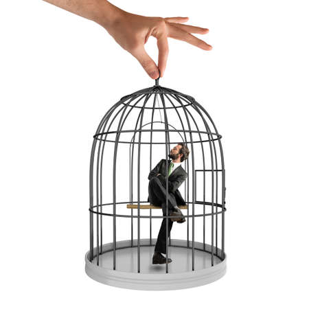 pent: Businessman sitting in a cage of birds