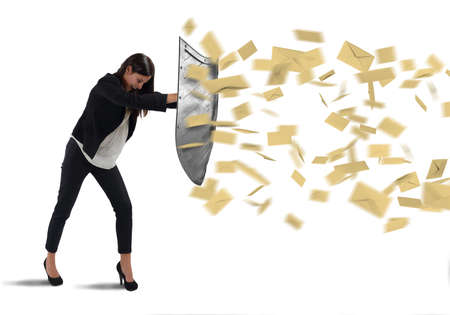 Businesswoman is protected with shield by letters