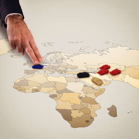 geographical: Fingers move tanks on the geographical map