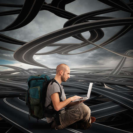 meditation help: Explorer with computer on winding roads background