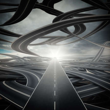 Big sunlit straight road on winding roads Stock Photo