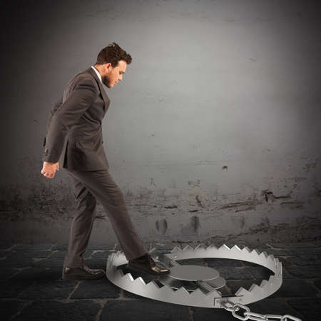 Man puts his leg in a trap