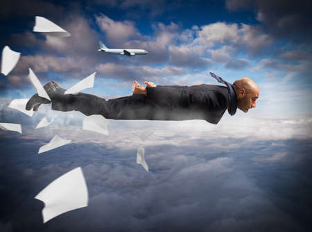 quickly: Man flying in the sky as airplane Stock Photo