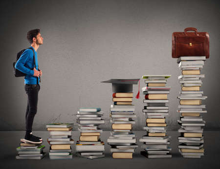 climb: Boy climbing the stairs made of books Stock Photo
